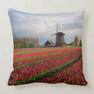 Red tulips and a windmill throw pillow