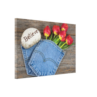 red tulips in blue jean pocket canvas print