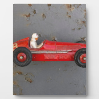 Red vintage toy car plaque