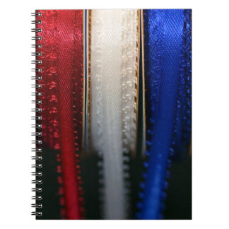 Red White and Blue ribbons on a notebook