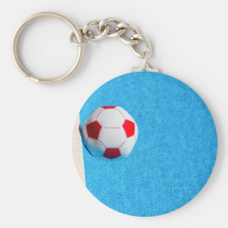 Red-white beach ball floating  in swimming pool basic round button keychain
