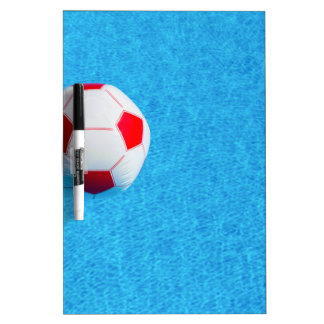 Red-white beach ball floating  in swimming pool dry erase board
