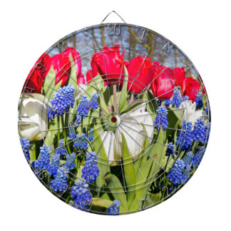 Red white blue flowers in spring season dartboard with darts