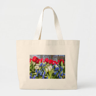 Red white blue flowers in spring season large tote bag