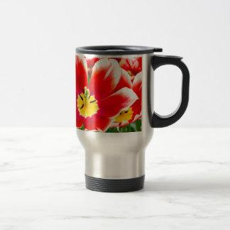 Red white tulip in field of tulips travel mug