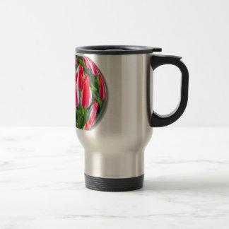 Red white tulips in glass sphere on white travel mug