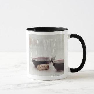 Red wine in stemless glasses mug