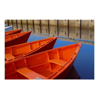 Red wooden boats docked on the bay poster