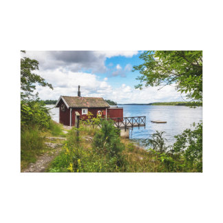 Red wooden cottage in Sweden Canvas Print