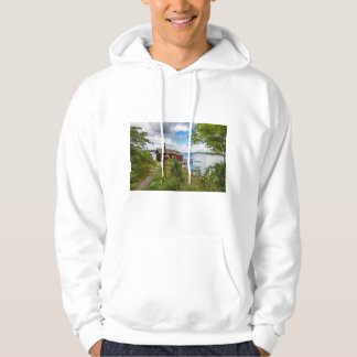 Red wooden cottage in Sweden Hoodie