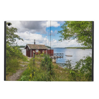 Red wooden cottage in Sweden iPad Air Cover