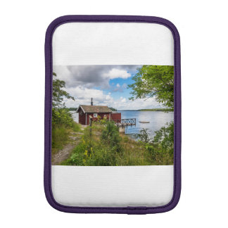 Red wooden cottage in Sweden iPad Mini Sleeve