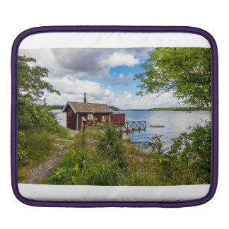 Red wooden cottage in Sweden iPad Sleeve