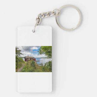Red wooden cottage in Sweden Keychain