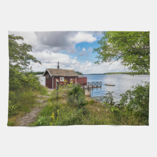 Red wooden cottage in Sweden Kitchen Towel