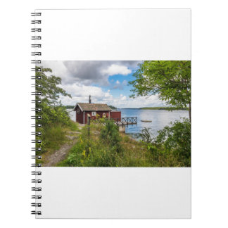 Red wooden cottage in Sweden Notebook