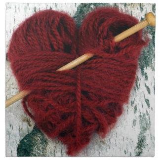Red wool heart on birch bark photograph napkin