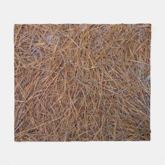 Reddish brown pine straw needles photo fleece blanket