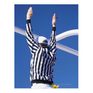 Referee signaling touchdown or successful field postcard