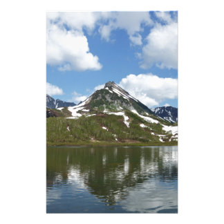 Reflection of sky and clouds in mountain lake stationery