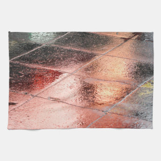 Reflections in a wet pavement kitchen towel