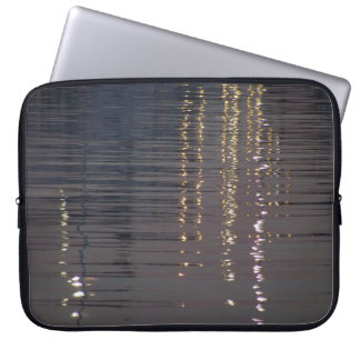 Reflections of lights in the sea computer sleeve