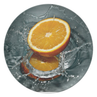 Refreshing drench of orange in water plate