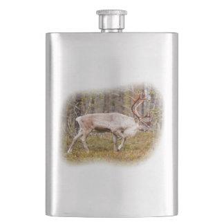 Reindeer walking in forest hip flask