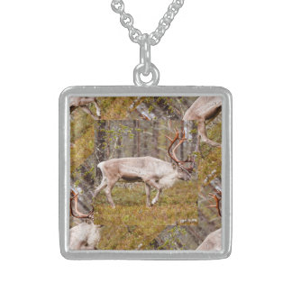 Reindeer walking in forest sterling silver necklace