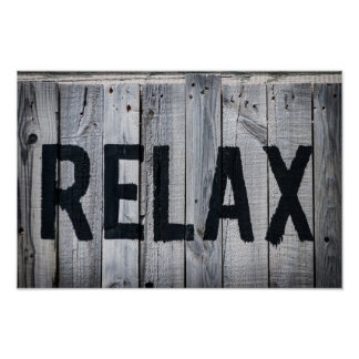 Relax message on sun bleached wood poster