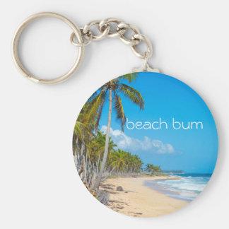 Relaxing beach scene with white 'beach bum' text keychain