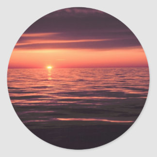 Relaxing sunset on the sea classic round sticker