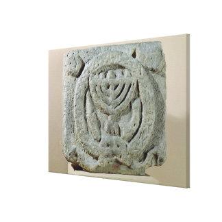 Relief depicting a menorah canvas print
