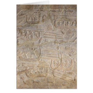 Relief depicting the unloading of wood card