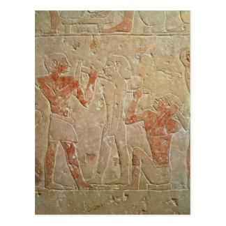 Relief depicting two sculptors carving a postcard