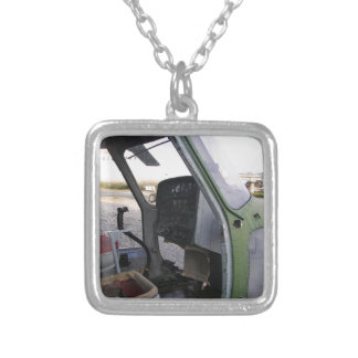 Remains of cold war helicopter. silver plated necklace