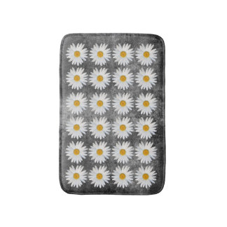 Repeated Daisy Pattern on Black and White Texture Bath Mat