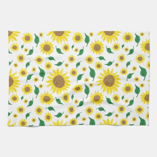 Repeating pattern of sunflowers on a kitchen towel
