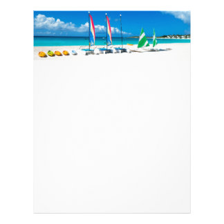 Resort's beach with boats on it letterhead