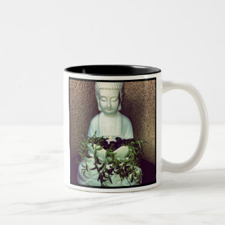 Resting Buddha with candle and plants Two-Tone Coffee Mug