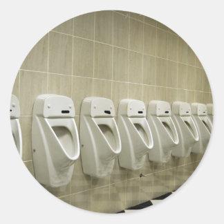 restroom interior with urinal row round sticker