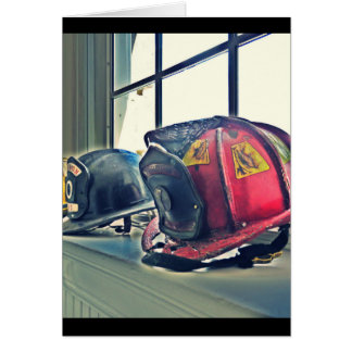 Retired fire helmets line the window sill card