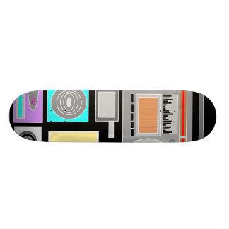 Retro electronics jumble on black skate boards