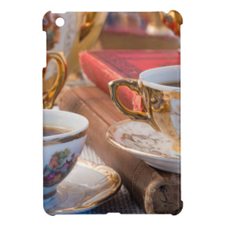 Retro porcelain coffee cups with hot espresso iPad mini covers
