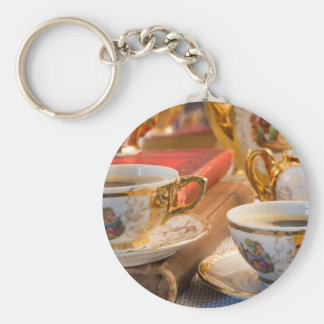 Retro porcelain coffee cups with hot espresso keychain
