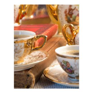 Retro porcelain coffee cups with hot espresso letterhead