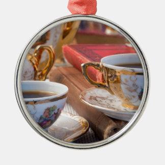 Retro porcelain coffee cups with hot espresso metal ornament