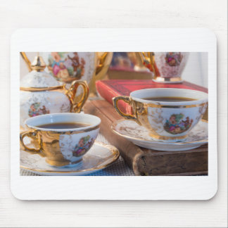 Retro porcelain coffee cups with hot espresso mouse pad