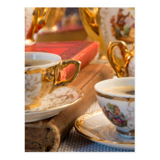 Retro porcelain coffee cups with hot espresso postcard