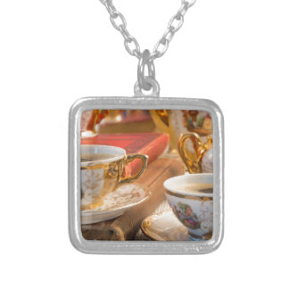Retro porcelain coffee cups with hot espresso silver plated necklace